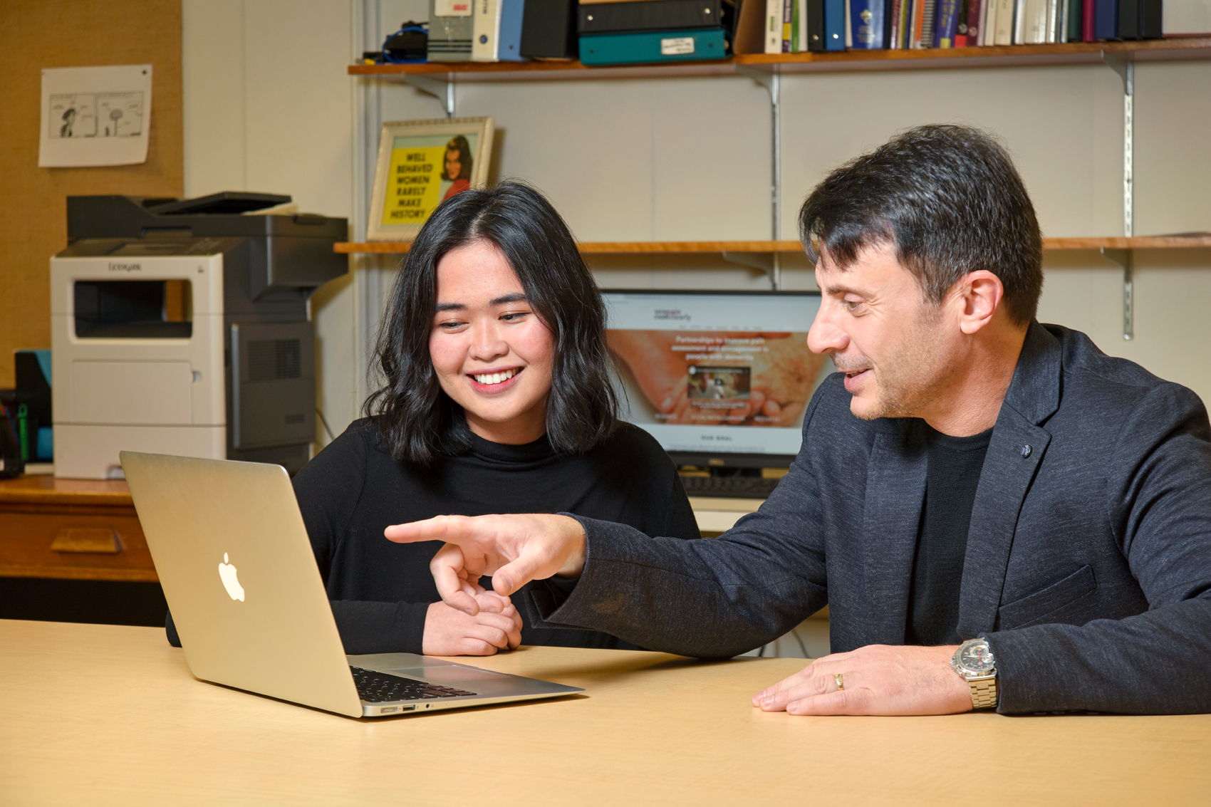 Thomas Hadjistavropoulos and psycholgoy student Louise Castillo working on the #SeePainMoreClearly campaign. (Photo by Trevor Hopkin)
