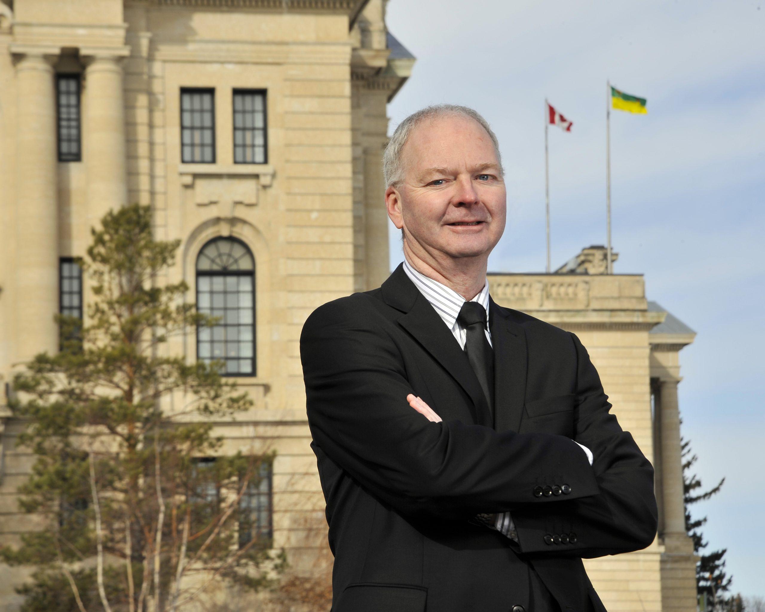 Raymond Blake in front of the Saskatchewan Legislature.