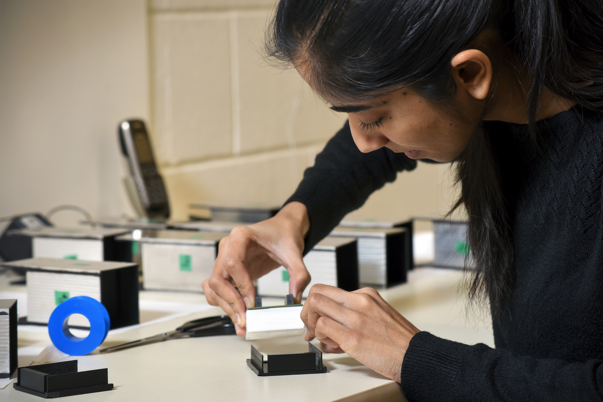 Master's student Shweta Sharma assembles the modules for the BioPETx. (Photo by Trevor Hopkin)