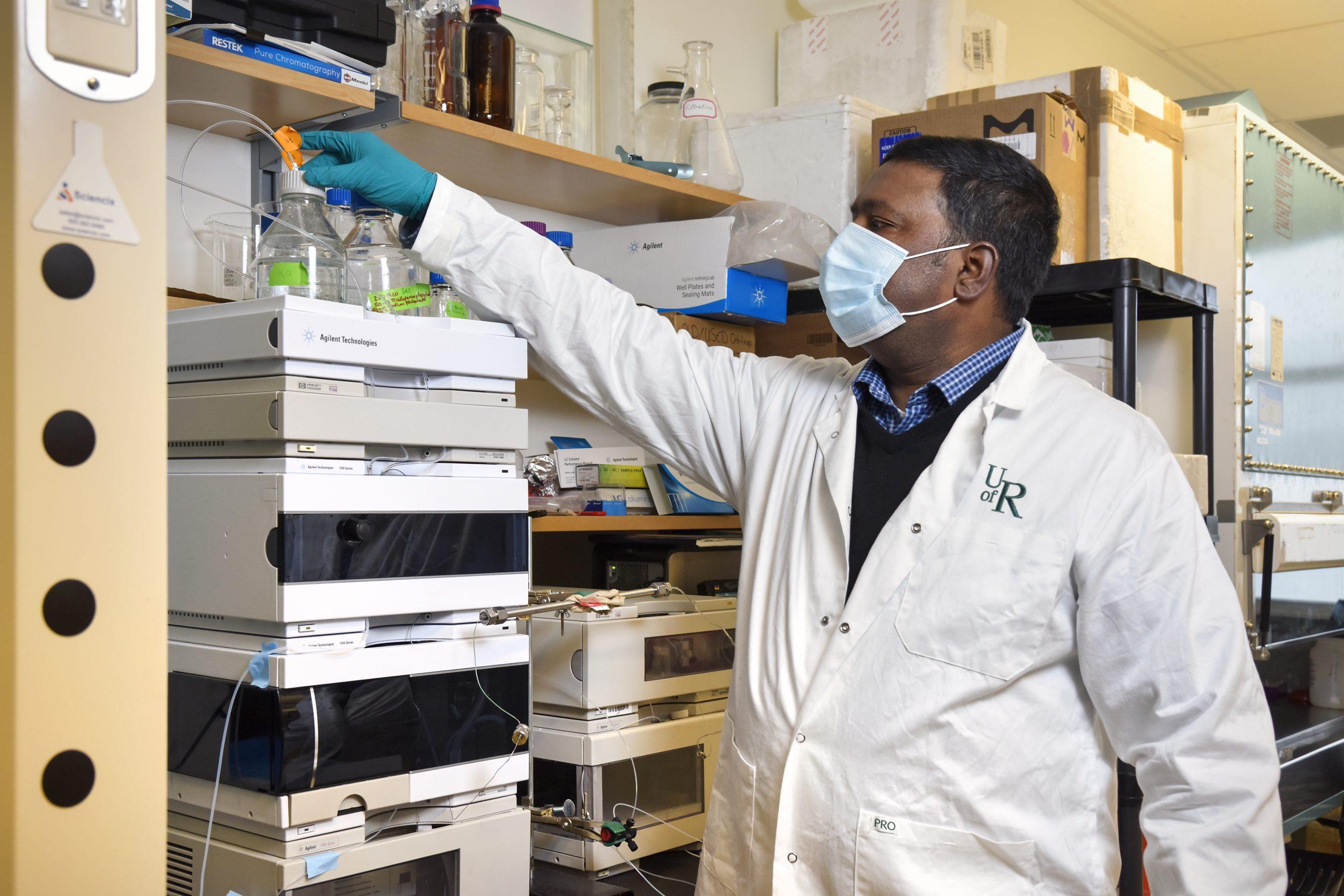 Biochemist Dr. Mohan Babu in his University of Regina lab processing samples in the high performance liquid chromatography (HPLC) machine. HPLC is a technique in analytical chemistry used to separate, identify, and quantify each component in a liquid mixture. (Photo by Trevor Hopkin)